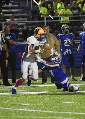 Katie Fyfe | The Journal Gazette Homestead senior Isaac Barkes tries to elude Carroll senior Jameson Coverstone during the second quarter of Friday's game at Carroll High School.
