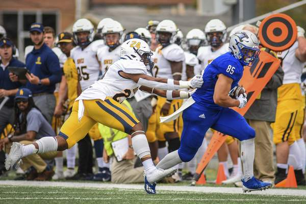 Mike Moore | The Journal Gazette University of Saint Francis wide receiver Jay Segal carries the ball for a gain on Saturday in the second quarter against Siena Heights at Bishop D'Arcy Stadium.
