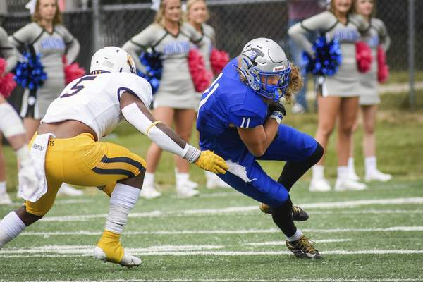 Mike Moore | The Journal Gazette University of Saint Francis wide receiver Devin Senerius turners to run after receiving a pass on Saturday against Siena Heights.
