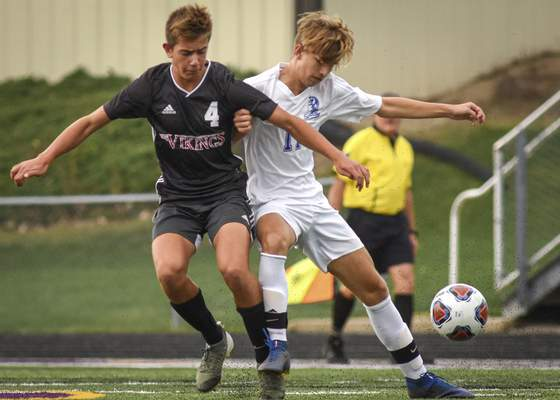 Mike Moore | The Journal Gazette Huntington North's Benjamin Claghorn and Homestead's Sampson Rupright battle for the ball Wednesday at New Haven High School.