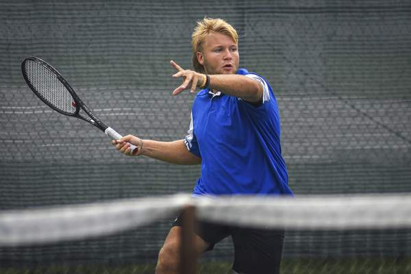Mike Moore | The Journal Gazette Ethan Koeneman won 6-1, 6-4 at No. 2 singles Wednesday, helping the Chargers claim the regional title at Carroll.