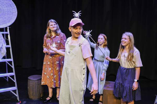 Mike Moore | The Journal Gazette From the left, Madison Rosine, Zidon Spradling as Wilbur, Quinn Brehmer and Olivia More, pose on stage for a photo during rehearsal for the Fort Wayne YouTheatre's production of Charlotte's Web opening Friday.