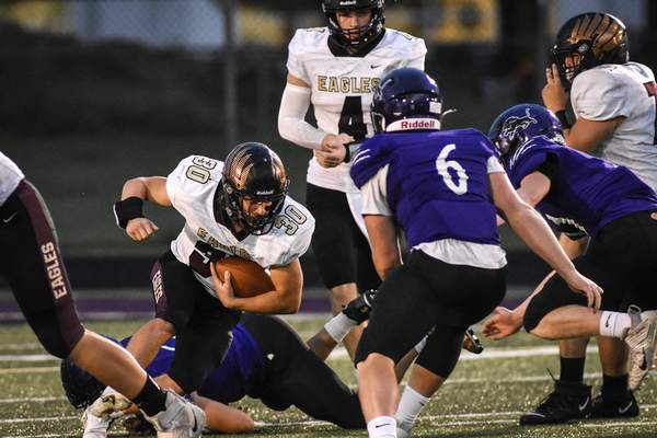 Mike Moore   The Journal Gazette Columbia City running back Abe Barrera carries the ball in the first quarter against Leo on Friday.