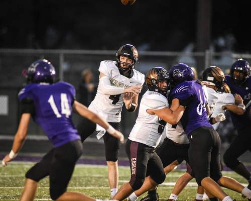 Mike Moore   The Journal Gazette Columbia City quarterback Gregory Bolt passes the ball Friday in the first quarter against Leo.