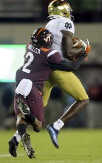 Notre Dame Virginia Tech Football Notre Dame wide receiver Kevin Austin Jr., right, catches a pass in front of Virginia Tech defensive back Jermaine Waller (2) during the first half of an NCAA college football game in Blacksburg, Va., Saturday, Oct. 9, 2021. (AP Photo/Matt Gentry) (Matt Gentry FRE)