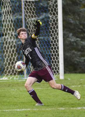 Katie Fyfe | The Journal Gazette  Concordia Lutheran senior Garrett Werling throws the ball out of the goalie box during the first half against Canterbury at Canterbury High School on Saturday.