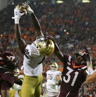 Matt Gentry   Associated Press Notre Dame wide receiver Kevin Austin Jr. (4) catches a two-point conversion pass in front of Virginia Tech defensive back Nasir Peoples (31) during the second half of an NCAA college football game in Blacksburg, Va., Saturday.