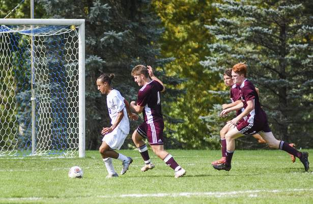 Katie Fyfe | The Journal Gazette  Canterbury junior Donovan Doolittle scores a goal during the first half against Concordia Lutheran at Canterbury High School on Saturday.
