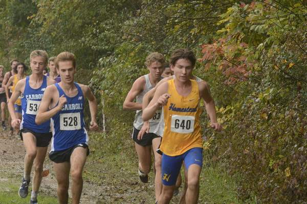 VICTORIA JACOBSEN   The Journal Gazette  Ethan Baitz of Homestead (right, wearing bib No. 640) and Carroll's Robert Lohman (528) lead a pack of runners midway through Saturday's Northrop Cross Country Sectional Championship. Lohman finished second and Baitz third in the race.