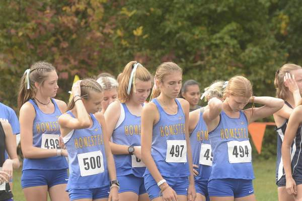 Victoria Jacobsen   The Journal Gazette The Homestead girls cross country team, including individual winner Addison Knoblauch, front center, prepare to start.