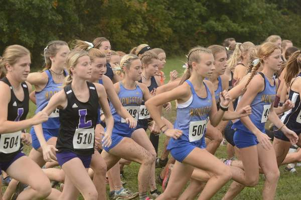 Victoria Jacobsen  The Leo girls (left, in black singlets) and Homestead girls (in light blue) kick up mud at the start of the Northrop Cross Country Sectional race on Saturday. The Spartans finished second and the Lions fourth in the team standings, so both teams will advance to next week's West Noble Regional Championship.