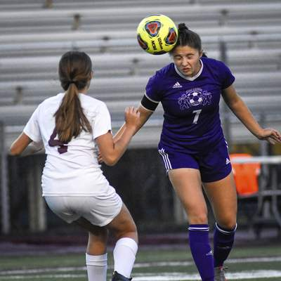 Mike Moore | The Journal Gazette Leo midfielder Audrey Abel stops the ball Saturday in the first half against Concordia at Zollner Stadium.