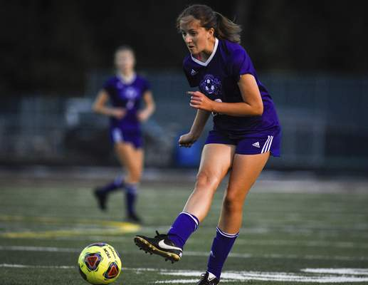 Mike Moore | The Journal Gazette Lio senior Lauren Bailey kicks the ball in the first half against Concordia at Zollner Stadium on Saturday.