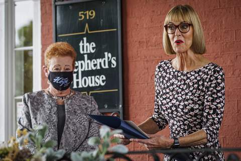 Mike Moore | The Journal Gazette Lt. Gov. Suzanne Crouch presents the Sagamore of the Wabash Award to local philanthropist Jane Surbeck in September 2020 at the Shepherd's House.