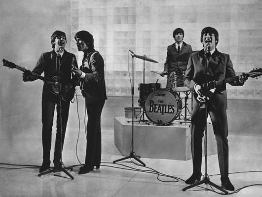 FILE - The Beatles are seen performing, date unknown. From left to right: Paul McCartney, George Harrison, Ringo Starr, and John Lennon. (AP Photo)