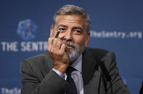 FILE - In this Sept. 19, 2019 file photo, US actor and activist George Clooney speaks at a press conference in London. (AP Photo/Alastair Grant)
