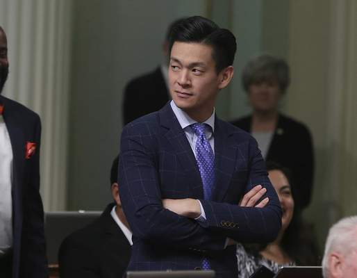 FILE - In this Aug. 31, 2018, file photo, Assemblyman Evan Low, D-Campbell, watches the debate over a bill during the Assembly session in Sacramento, Calif. (AP Photo/Rich Pedroncelli, File)