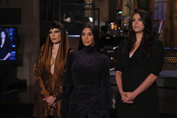 This image provided by NBC shows Episode 1807 musical guest Halsey, from left, host Kim Kardashian West, and Cecily Strong during promos for Saturday Night Live in Studio 8H on Thursday, Oct. 7, 2021. (Rosalind O'Connor/NBC via AP)