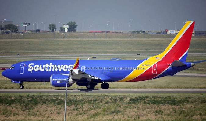 A Southwest Airlines jetliner taxis down a runway for take off from Denver International Airport Friday, July 2, 2021, in Denver. (AP Photo/David Zalubowski, file)