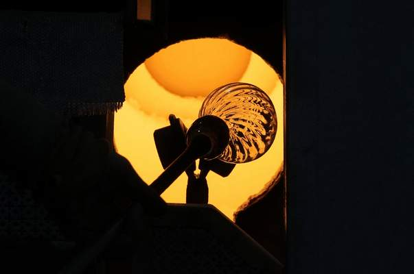 Associated Press A glass worker heats a glass artistic creation last week in a methane-powered oven in Murano island, Venice, Italy.