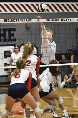 Mike Moore | The Journal Gazette Bellmont senior Katelyn Rumschlag extends for the ball Tuesday against Heritage in Decatur.