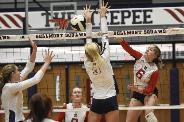Mike Moore | The Journal Gazette Heritage junior Claire Bickel hits it over the net against Bellmont Tuesday in Decatur.
