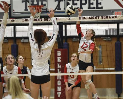 Mike Moore | The Journal Gazette Heritage junior Alyson Stinson hits it over the net against Bellmont Tuesday in Decatur.
