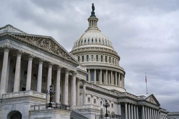 The Capitol is seen as members of the House of Representatives vote on a short-term lift of the nation's debt limit and ensure the federal government can continue fully paying its bills into December, at the Capitol in Washington, Tuesday, Oct. 12, 2021. (AP Photo/J. Scott Applewhite)