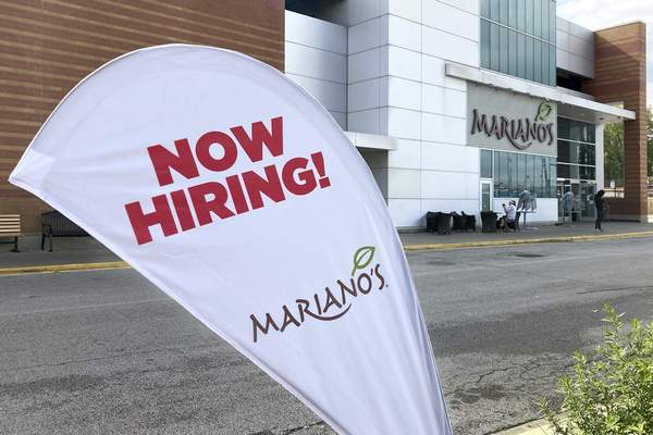 A sign in the parking lot of Mariano's grocery store advertises the availability of jobs Friday, Oct. 8, 2021, in Chicago. (AP Photo/Charles Rex Arbogast)