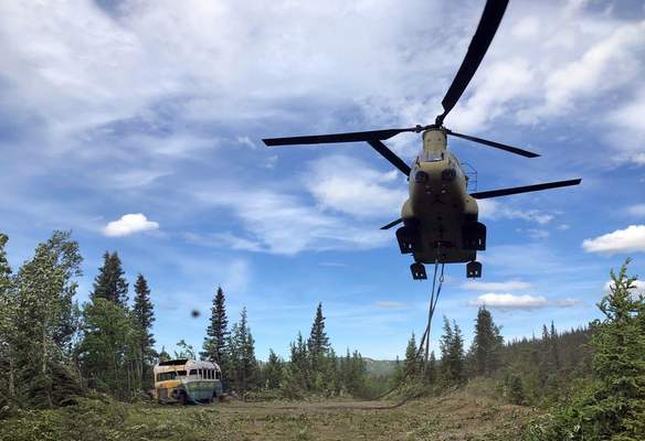 FILE - In this June 18, 2020, file photo released by the Alaska National Guard, Alaska Army National Guard soldiers use a CH-47 Chinook helicopter to removed an abandoned bus, popularized by the book and movie Into the Wild, out of its location in the Alaska backcountry as part of a training mission. (Sgt. Seth LaCount/Alaska National Guard via AP, File)