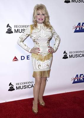 FILE - In this Feb. 8, 2019 file photo, Dolly Parton arrives at MusiCares Person of the Year in her honor at the Los Angeles Convention Center. (Photo by Jordan Strauss/Invision/AP, File)