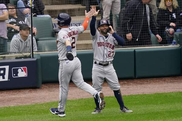 Associated Press The Astros' Alex Bregman, left, and Jose Altuve celebrate after scoring in the third inning of Tuesday's win over the White Sox in Chicago.