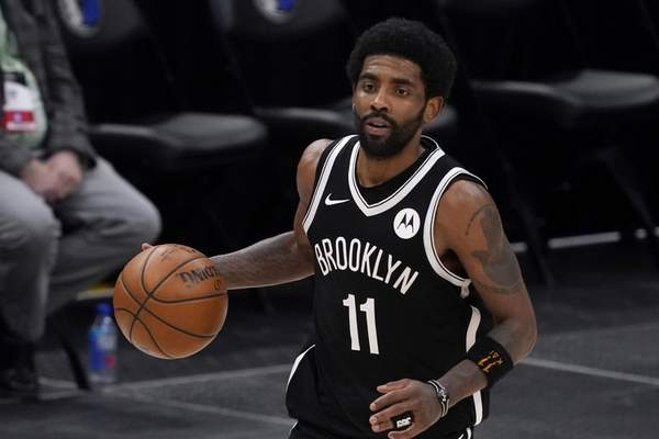 Irving FILE - Brooklyn Nets guard Kyrie Irving handles the ball during an NBA basketball game against the Dallas Mavericks in Dallas, in this Thursday, May 6, 2021, file photo. Unable to attend the Brooklyn Nets' media day, Kyrie Irving asked for privacy Monday when pressed about his vaccination status and availability for home games. (AP Photo/Tony Gutierrez)