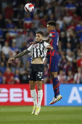 Costa Rica's Jonathan Moya, left, and United States' Chris Richards jump for a header during the first half of a World Cup qualifying soccer match Wednesday, Oct. 13, 2021, in Columbus, Ohio. (AP Photo/Jay LaPrete)