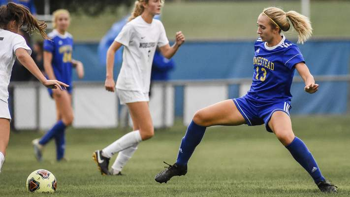 Mike Moore | The Journal Gazette Homestead midfielder Morgan Kaiser lunges for the ball in the first half against Noblesville on Wednesday.