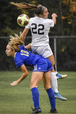Mike Moore | The Journal Gazette Homestead midfielder Morgan Kaiser, left, and Noblesville forward Kiana Siefert collide while infielding the ball in round one of the girls soccer regionals at Pat Teagarden Field Wednesday.