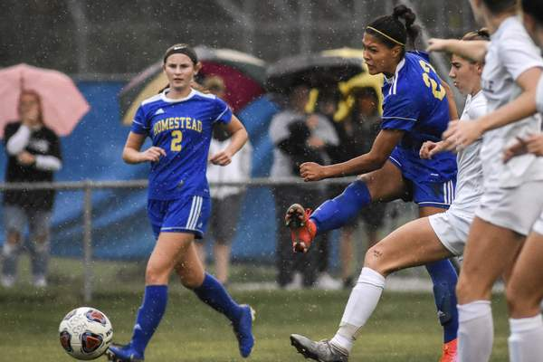Mike Moore | The Journal Gazette Homestead midfielder Amelia White, right, kicks a goal in the first half against Noblesville on Wednesday.
