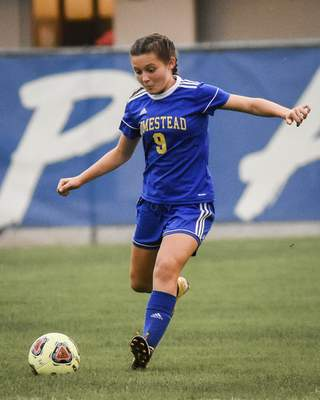 Mike Moore | The Journal Gazette Homestead midfielder Madison Balf kicks the the ball in the first half against Noblesville on Wednesday.