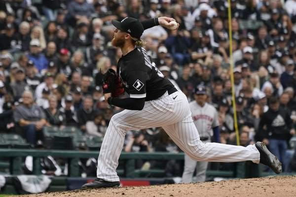Chicago White Sox pitcher Michael Kopech throws against the Houston Astros in the fourth inning during Game 4 of a baseball American League Division Series Tuesday, Oct. 12, 2021, in Chicago. (AP Photo/Nam Y. Huh)