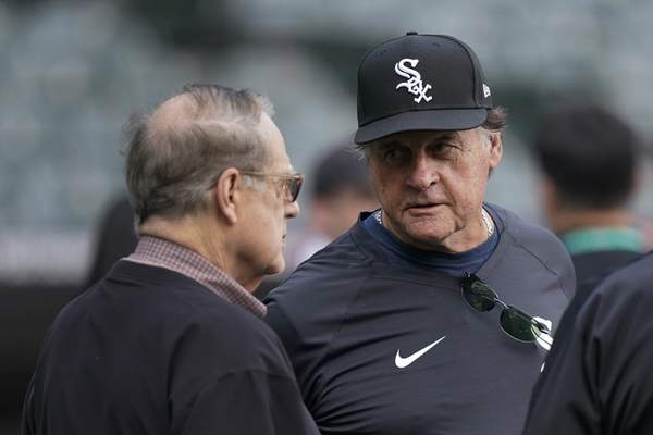 Chicago White Sox owner Jerry Reinsdorf, left, talks with Chicago White Sox manager Tony La Russa before Game 3 of a baseball American League Division Series against the Houston Astros, Sunday, Oct. 10, 2021, in Chicago. (AP Photo/Nam Y. Huh)