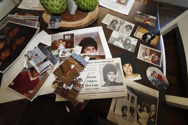 FILE - In this Aug. 12, 2019, file photo, family photographs of Jonelle Matthews, who went missing just before Christmas 1984 and whose remains were found in Greeley, Colo. in 2019, sit on a table in a home in Greeley. (AP Photo/David Zalubowski, File)