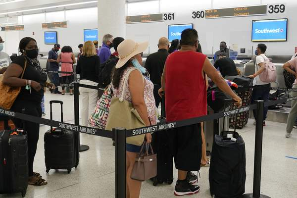 Southwest passengers wait to check in at Miami International Airport, Tuesday, Oct. 12, 2021, in Miami. (AP Photo/Marta Lavandier)