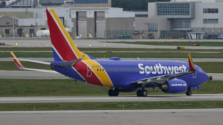 A Southwest Airlines jetliner taxis down a runway at Cleveland Hopkins International Airport, Tuesday, Oct. 12, 2021, in Cleveland. (AP Photo/Tony Dejak)