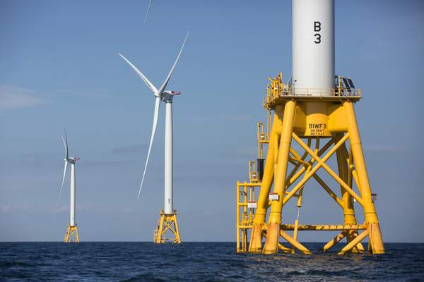 FILE - In this Aug. 15, 2016 file photo, three of Deepwater Wind's five turbines stand in the water off Block Island, R.I, the nation's first offshore wind farm. (AP Photo/Michael Dwyer, File)