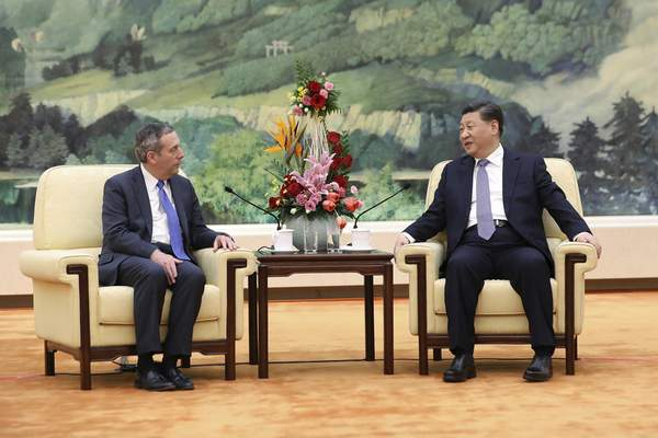 FILE - In this March 20, 2019, file photo, Chinese President Xi Jinping, right, meets with Harvard University President Lawrence Bacow at the Great Hall of the People in Beijing. An intensive summer language program hosted by Harvard University in Beijing will relocate to Taiwan in summer of 2022, as the U.S.-China relationship remains strained. (Andrea Verdelli/Pool Photo via AP, File)