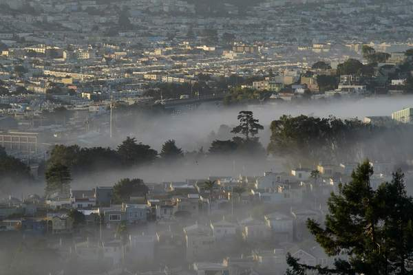 FILE - In this Oct. 20, 2020, file photo low-lying morning fog is shown over San Francisco. (AP Photo/Jeff Chiu, File)