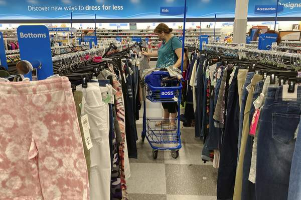 In this July 21, 2021 photo, a consumer shops at a retail store in Morton Grove, Ill. (AP Photo/Nam Y. Huh)