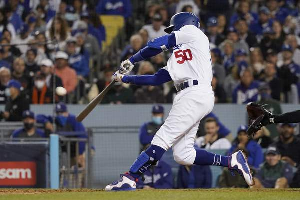 Los Angeles Dodgers' Mookie Betts hits a two-run home run during the fourth inning against the San Francisco Giants in Game 4 of a baseball National League Division Series, Tuesday, Oct. 12, 2021, in Los Angeles. (AP Photo/Marcio Jose Sanchez)