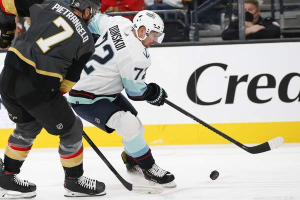 Seattle Kraken right wing Joonas Donskoi (72) skates with the puck under pressure from Vegas Golden Knights defenseman Alex Pietrangelo (7) during the third period of an NHL hockey game Tuesday, Oct. 12, 2021, in Las Vegas. (AP Photo/Chase Stevens)