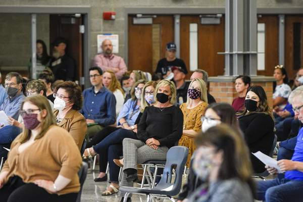 Mike Moore | The Journal Gazette Residents gather inside the cafeteria at Carroll High School during a NACS school board meeting in April.